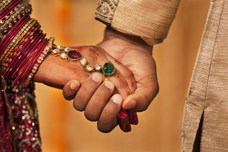 Close-up of hands of newly married Indian couple Stock Photo