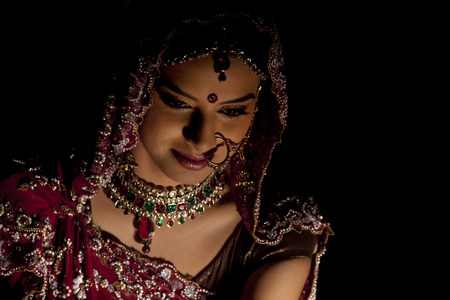customs and celebrations: Close-up of Indian bride in wedding attire and jewelery