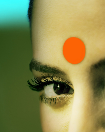 Close-up of eye and bindi of a woman Stock Photo