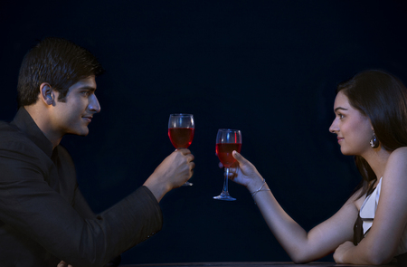 welldressed: Romantic young couple toasting on date