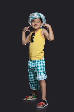 roll out: Portrait of boy over black background