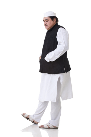 Politician walking with eyes closed over white background Stock Photo