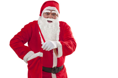 Portrait of Santa Claus removing gift from bag over white background Stock Photo