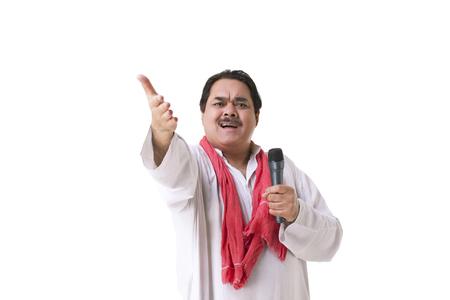 kurta: Male politician with microphone gesturing