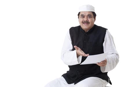 kurta: Portrait of mature politician holding document