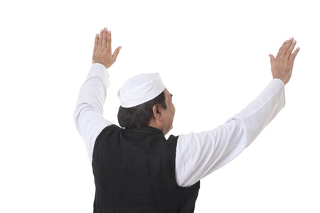 Back view of politician with raised hands