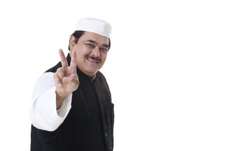 kurta: Happy politician gesturing V-sign Stock Photo