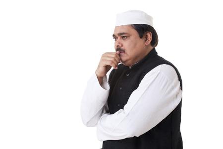 kurta: Mature politician contemplating Stock Photo