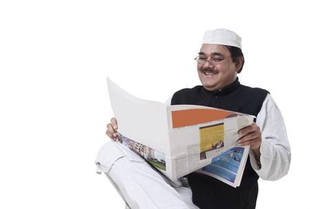 kurta: Happy politician reading newspaper