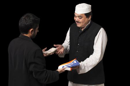Male politician taking a bribe Stock Photo