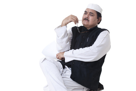Pensive politician looking away over white background Stock Photo