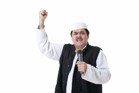 Male politician with microphone making a fist