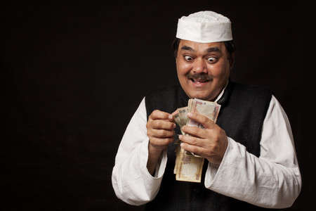 Greedy mature politician counting money over black background