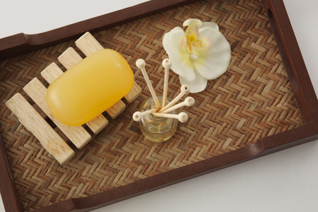 Soap,reed diffuser and orchid in a tray