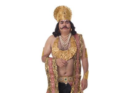 Man dressed as Raavan looking unhappy