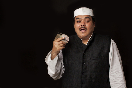 corrupt: Portrait of Indian politician holding paper currency Stock Photo