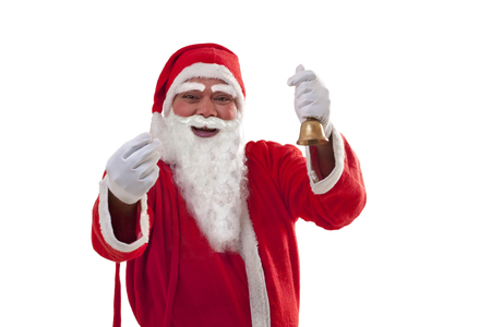 one mature man only: Portrait of cheerful Santa Claus gesturing while holding bell over white background