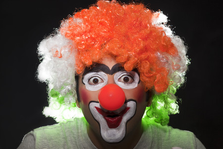 Surprised male clown over black background Stock Photo