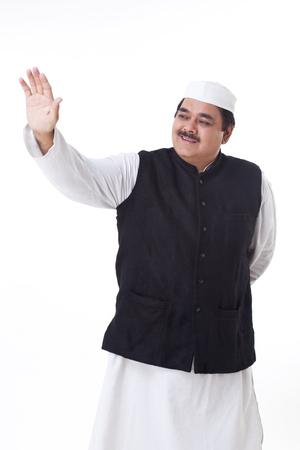 Smiling politician waving his hand