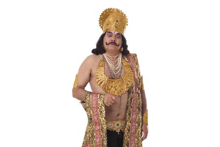 Man dressed as Raavan looking serious