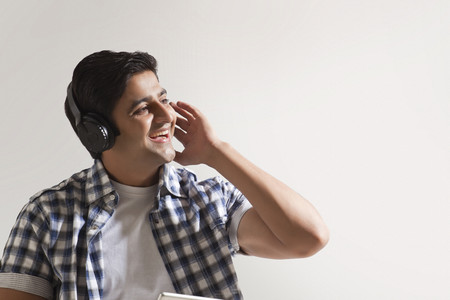 Cheerful young man wearing headphones