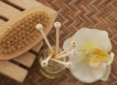 bodycare: Close-up of reed diffuser with foot brush and orchid