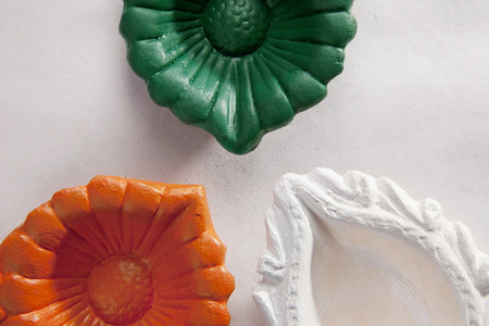 tricoloured: Different coloured diyas