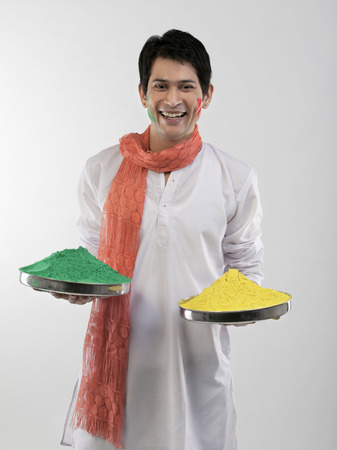 Man holding trays with colours