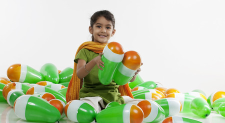 Girl sitting with balloons Imagens