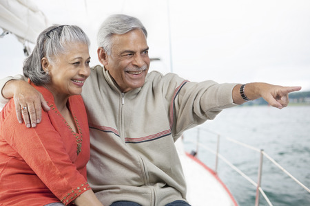 Old couple looking at something Stock Photo