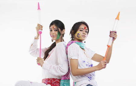 Women holding pichkaris