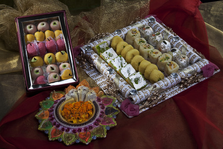 unlit: Sweet dishes with unlit diyas Stock Photo