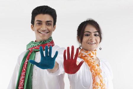 Young couple with coloured palms