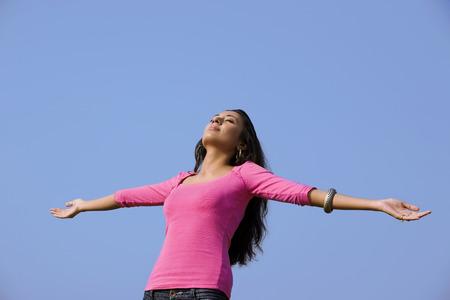 Woman enjoying the outdoors Stock Photo