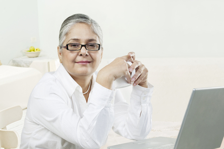 55 years old: Old woman with a laptop