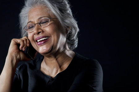 Old woman with glasses smiling Stock Photo