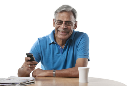 Portrait of an old man with a mobile phone