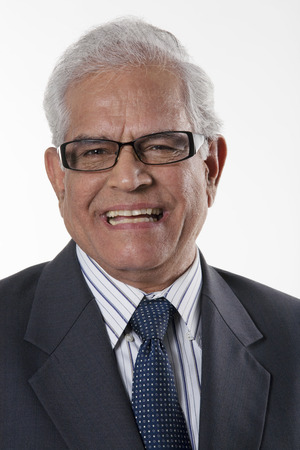 Portrait of an old businessman smiling