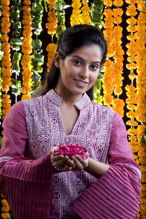 kurta: Woman offering flowers