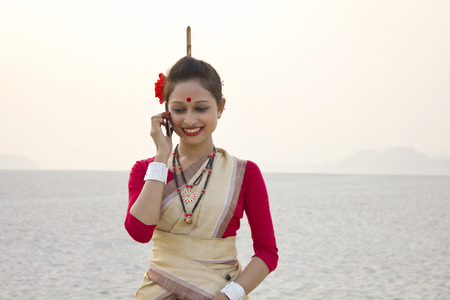 Bihu woman talking on a mobile phone