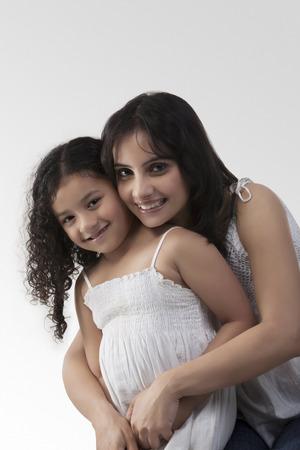 joyfulness: Portrait of mother and daughter