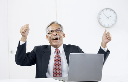 Old businessman rejoicing