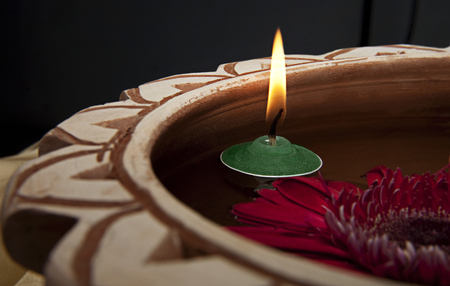 A pink flower and a candle Stock Photo