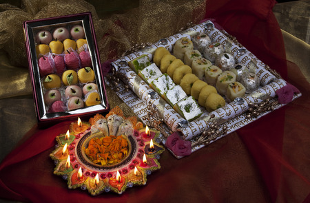 Sweet dishes with diyas