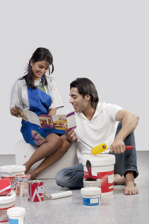 indian paint brush: Couple looking at a paint brochure