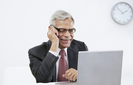 Old businessman surfing the net