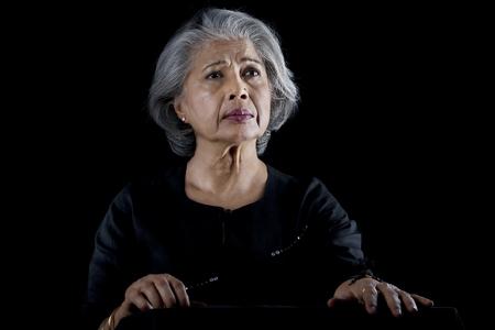 60 65 years: Old woman worried