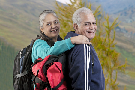 Portrait of old couple with hiking gear