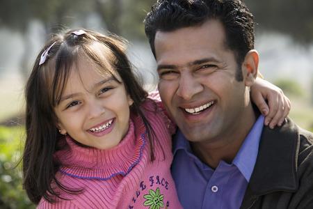 joyfulness: Father and daughter smiling