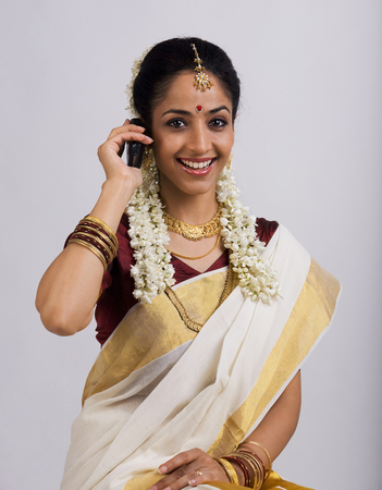 gajra: South Indian woman with cell phone Stock Photo